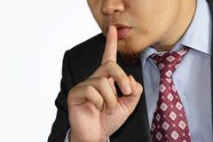Gesto masculino de la boca del finger del hombre de negocios shh Imagen de archivo