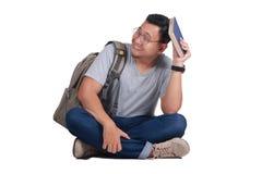 Gesto triste de Reading Book Regret del estudiante joven Imagen de archivo libre de regalías