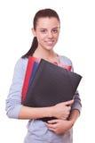 Gestore o contabile della donna con i dispositivi di piegatura Immagini Stock Libere da Diritti