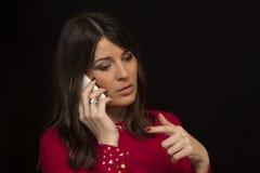 Gestos durante a fala com um telefone Imagens de Stock