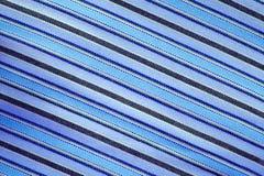 Gestreepte blauwe stof als achtergrond De materialen van textuurpatronen Stock Fotografie