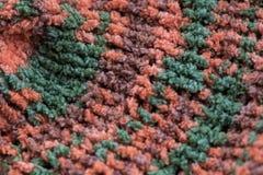 Gestreepte bruin, groen en de sinaasappel breit stoffentextuur, gebreide pa stock afbeeldingen
