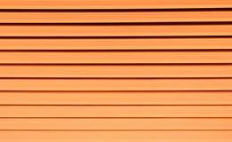 Gestreepte oranje kleur - Achtergrondtextuur en samenvatting Royalty-vrije Stock Fotografie