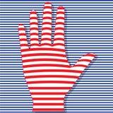 Gestreifte Hand auf gestreiftem Hintergrund Stockfotos