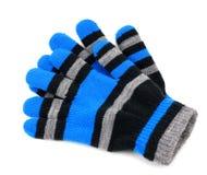 Gestreifte Handschuhe lokalisiert auf Weiß Stockfoto