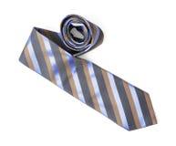 Gestreifte Krawatte auf dem weißen Hintergrund, der Schönheit und der Mode lizenzfreie stockfotos