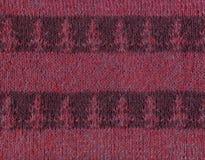 Gestreifte Maschenware mit einem Muster von Tannenbäumen Stockbild