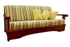 Gestreiftes grünes und braunes Sofa Lizenzfreies Stockfoto
