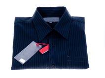 Gestreiftes Hemd getrennt auf dem Weiß Lizenzfreies Stockfoto