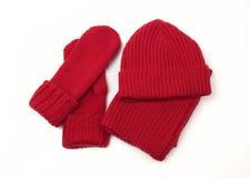 Gestrickte Schutzkappe; Schal und Handschuhe Stockfotos