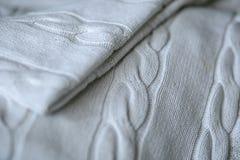 Gestrickte weiße Decke Stockbild