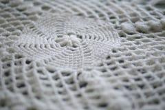 Gestrickte weiße Decke Stockfotografie