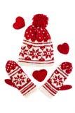 Gestrickte Winterschutzkappe und -handschuhe. auf Weiß Stockbilder