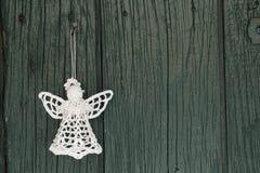 Gestrickter Engel für Weihnachtsgrußkarte Stockfotografie