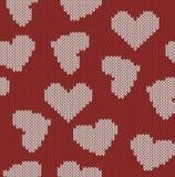 Gestrickter Hintergrund mit dem Bild von Herzen Stockfotografie