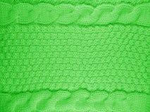 Gestrickter Wollhintergrund - Grün Stockbild