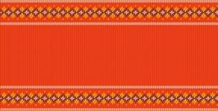 Gestricktes Muster auf orange Hintergrund mit Platz für Text Lizenzfreie Stockbilder