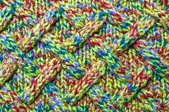Gestricktes Muster auf woolen Kleidung, Hintergrund, Tapete lizenzfreies stockbild