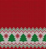 Gestricktes Weihnachts- und des neuen Jahresmuster Stockfotos