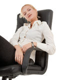 Gesture of comfort. Business woman sitting in a chair on white Royalty Free Stock Photo