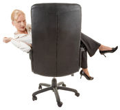 Gesture of comfort. Business woman sitting in a chair on white Stock Image