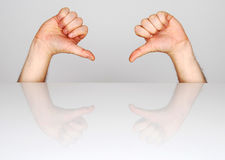 Gesture of defeat. Two hands showing the gesture of defeat Royalty Free Stock Photography
