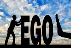 Gesture of the hand stop and silhouette of the man pushing the word ego. The concept of egoism as a problem in society Stock Images
