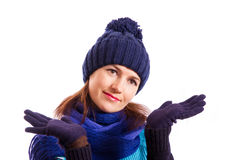 A gesture with her hands sorry. Smiling girl shows a gesture with her hands sorry on a white background Stock Photos