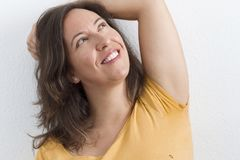 Gesture of joy. A woman with a happy gesture on her face royalty free stock photography
