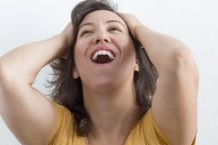 Gesture of joy. A woman with a happy gesture on her face royalty free stock images