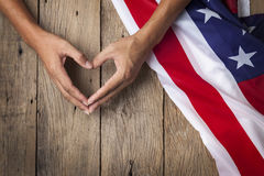 Gesture made by hands showing symbol of heart with american flag Royalty Free Stock Images
