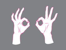 Gesture. Okey sign. Two female hands with index and thumb making circle, other fingers up. Stock Image
