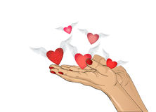 Gesture open palms. From stacked hands fly red heart with wings. Royalty Free Stock Photos