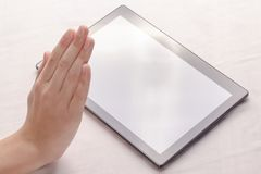 Gesture of refusal. Tablet PC royalty free stock photos