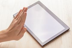Gesture of refusal. Tablet PC stock photos