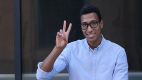 Gesture of Success, Victory Sign by Young Black Handsome Man Royalty Free Stock Images