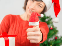 Gesture thumb up in new year Royalty Free Stock Photo