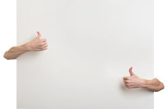 Gesture thumbs up and blank white paper Stock Images
