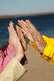 Gesture of welcome adults and children. Royalty Free Stock Photography