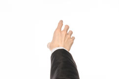 Gestures and Business theme: businessman shows hand gestures with a first-person in a black suit on a white background isolated Royalty Free Stock Photography