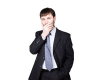 Gestures distrust lies. body language. man in business suit, hand closes his lips. isolated on white background. concept Royalty Free Stock Image