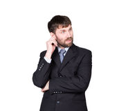Gestures distrust lies. body language. man in business suit, scratching, rubbing the ear. isolated on white background Stock Photo