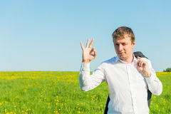 Gestures entrepreneur in the field Royalty Free Stock Photos