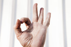 Gestures by hands Stock Images