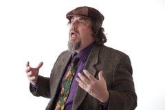 gesturing говорить тяжелого человека установленный Стоковая Фотография