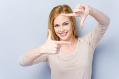 Gesturing finger frame. Stock Photo