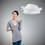 Gesturing forefinger to cloud Royalty Free Stock Photos