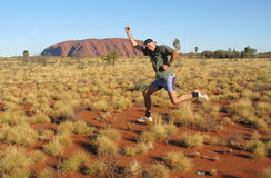 Gesturing in front of the Ayers Rock Royalty Free Stock Photography