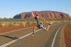 Gesturing in front of the Ayers Rock Royalty Free Stock Photo