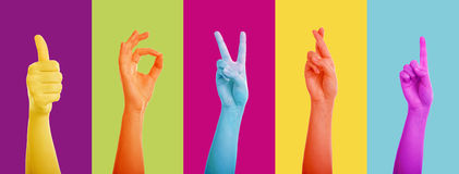 Gesturing hands. Colorful gesturing hands showing various signs Royalty Free Stock Photography